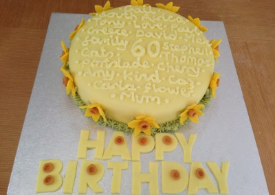 60th cake with personal words & daffodils