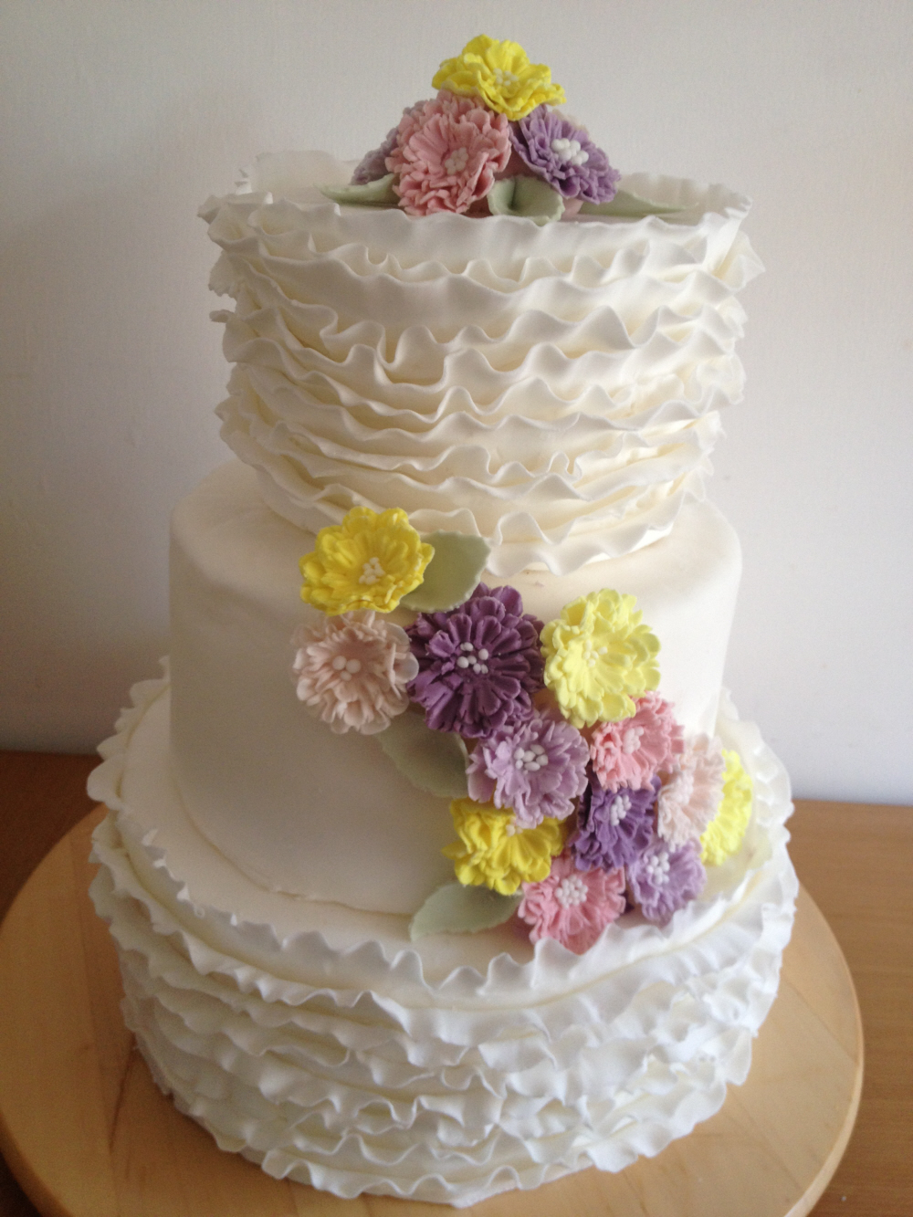 Ruffled 3 tired cake with flowers