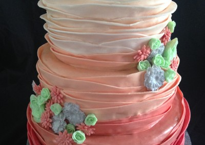 Ombre coral ruffles with mint, coral & sliver flowers